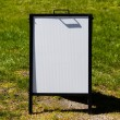 White sandwich board sign - Stock Photo