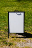 White sandwich board sign — Stock Photo