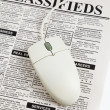 Classified Ad and computer mouse — Foto de Stock