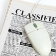 Stockfoto: Classified Ad and computer mouse