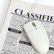 Foto Stock: Classified Ad and computer mouse