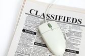 Classified Ad and computer mouse — Stock Photo