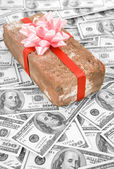 Prank gift and dollars — Foto Stock