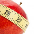 Stock Photo: Red apple and Tape Measure