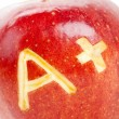 Red apple and A Plus sign — Stock Photo
