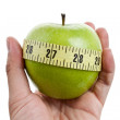 Green apple and Tape Measure — Stock Photo #8029545