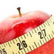 Red apple and Tape Measure — Stock Photo