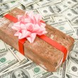 Stock Photo: Prank gift and dollars