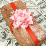 Prank gift and dollars — Stock Photo #8126572