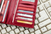 Red Wallet and keyboard — Foto Stock