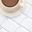 Coffee cup and Calendar — Stock Photo