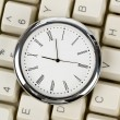 Clock and computer Keyboard - Stock Photo