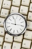 Clock and computer Keyboard — Stock Photo
