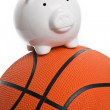 Piggy Bank and basketball — Stock Photo