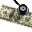 Royalty-Free Stock Photo: Stethoscope and dollar