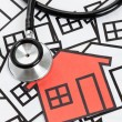 Foto Stock: Stethoscope and House