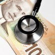 Stethoscope and Canadian dollar — Stock Photo
