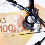 Stethoscope and Canadian dollar — Stock Photo