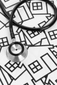 Stethoscope and House — Stock Photo