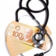 Stock Photo: Stethoscope and Canadian dollar