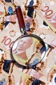 Lupa y dólar canadiense — Foto de Stock