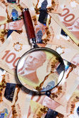 Magnifying glass and Canadian dollar — Stock Photo