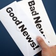 Stock Photo: Good News and bad news