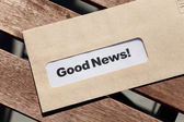 Good News and envelope — Stock Photo