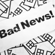 Bad News and Home Sign - Stock Photo