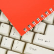 Red Note Pad and Keyboard — Stock Photo