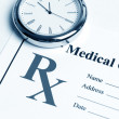 Stock Photo: Prescription and clock