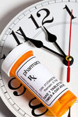 Clock and Pill Bottle — Stock Photo
