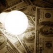 Stock Photo: Bright Light Bulb and Dollar
