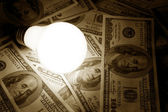 Bright Light Bulb and Dollar — Stock Photo