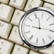Clock and computer Keyboard — Stock Photo #9570243
