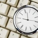 Clock and computer Keyboard — Stock Photo #9570243