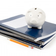 Blue school textbook and piggy bank — Stock Photo