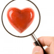 Red Heart and magnifier — Stock Photo #9751793