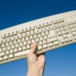 Computer Keyboard and blue sky - Stock Photo
