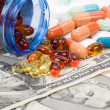 Medicine pills and dollar — Stockfoto