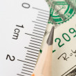 White ruler and dollar — Stock Photo