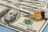 Syringe and dollar — Stock Photo