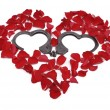 Heart made of roses with handcuffs inside — Stock Photo