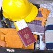 Suitcase with clothes of the worker - Stock Photo