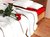 Beautiful red roses on the bed — Stock Photo