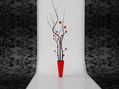 Beautiful red vase with branches — Stock Photo