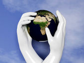 Earth is protected by human hands — Stock Photo