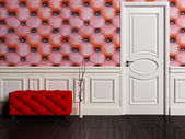 Interior scene with a door and pouf — Stock Photo