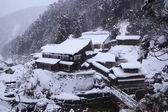 Hot spring resort in snow — Stock Photo
