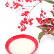 Japanese sweet mild sake and nandina domestica — Stock Photo